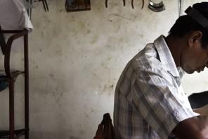An artisan in Sri Lanka crafts jewelry for Swiss brand Kinsfolk