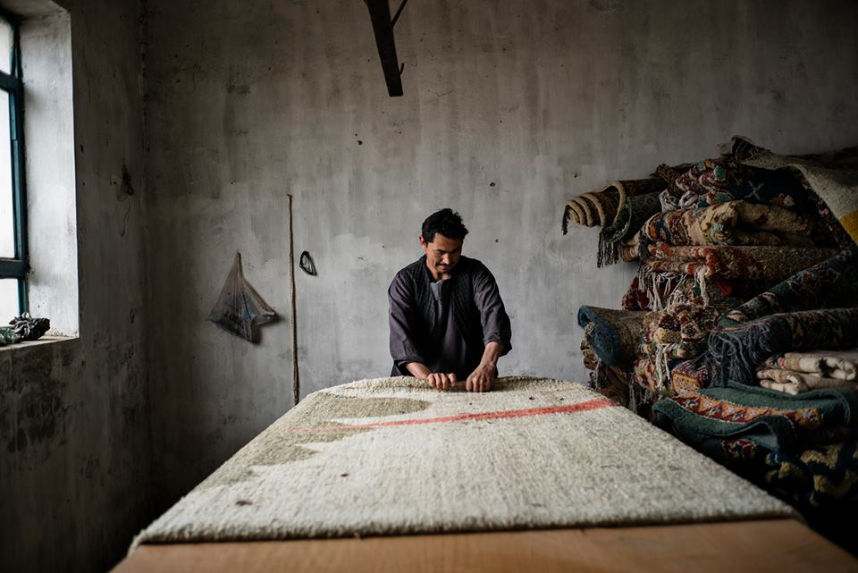 A carpet weaver in Afghanistan.  Ishkar courtesy photo
